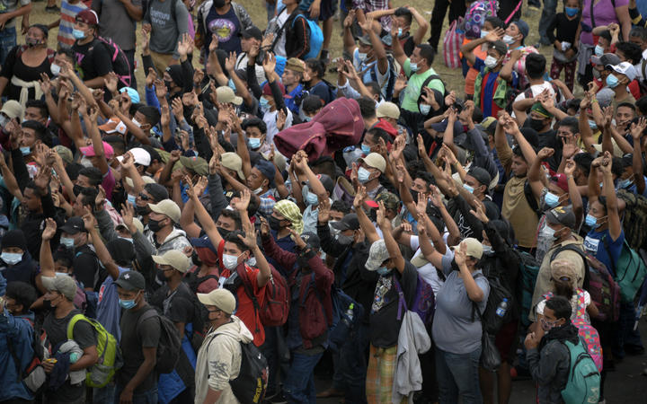 Honduran migrants, part of a caravan heading to the United States, gather to pray in Vado Hondo, Guatemala on January 17, 2021.