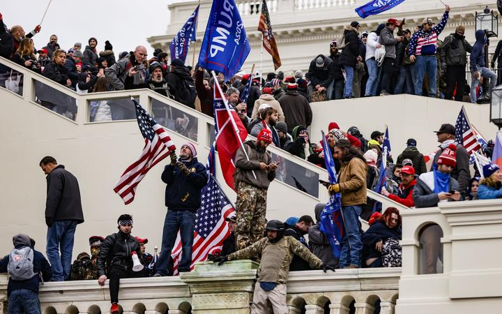 WASHINGTON, DC - JANUARY 06: Pro-Trump supporters storm the U.S. Capitol following a rally with President Donald Trump on January 6, 2021 in Washington, DC.