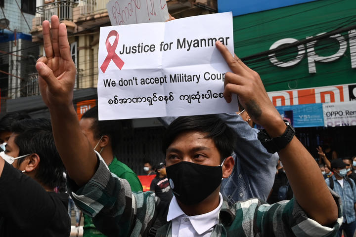 A protester in Yangon flashes the three-finger salute, which has become a symbol of defiance in the region.